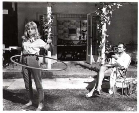 Lolita (played by Sue Lyton) is oggled by the pedophile Humbert Humbert (James Mason) in Stanley Kubrick's 1961 film version of Vladimir Nabokov's novel <i>Lolita</i>.