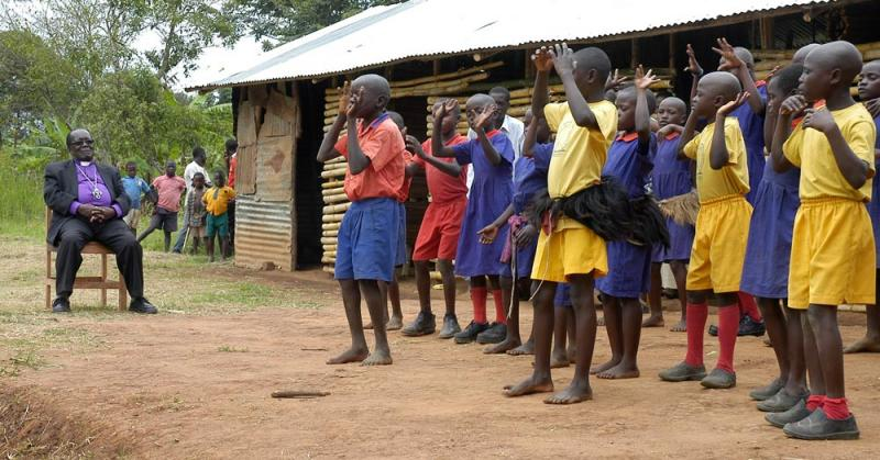 Bishop Christopher Senyonjo visiting a rural school in Uganda in Roger Ross Williams' new film <i>God Loves Uganda</i>