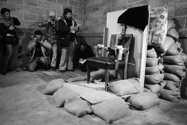 Journalists view the chair in which Gary Gilmore was executed by firing squad in 1977.