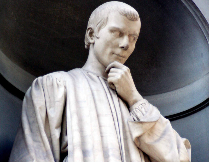 A statue of Niccolò Machiavelli outside the Uffizi Gallery in Florence, Italy.