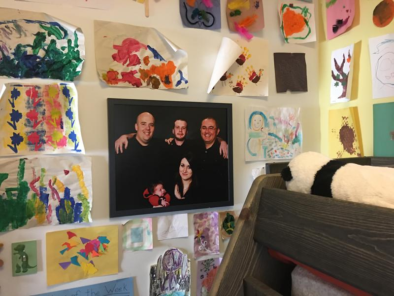 A picture of the the Bateman-Rapier family, with their son's birth parents, hangs in the 3-year-old's Salt Lake City bedroom.