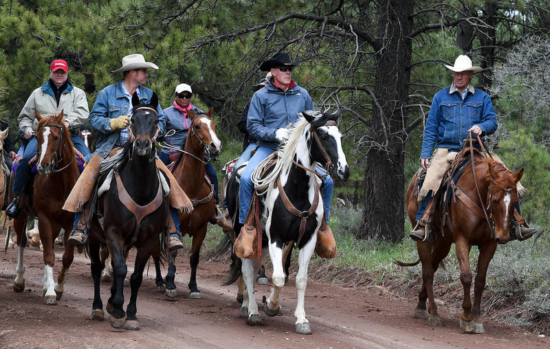 U.S. Secretary of the Interior Ryan Zinke (center, black hat) tours Bears Ears National Monument in May 2017
