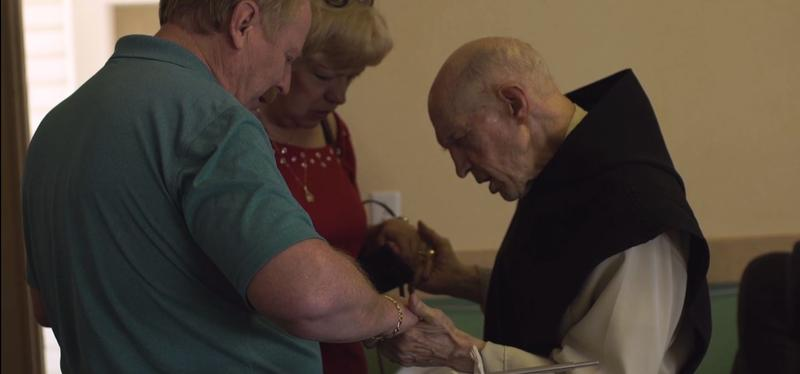 Fr. Patrick prays with friends during his final days at Abbey of Our Lady of the Holy Trinity in Huntsville, Utah.