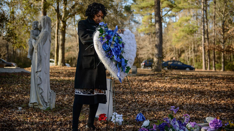 Claudia Lacy visits the grave of her son, Lennon Lacy