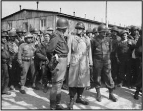 The then General Dwight D. Eisenhower pictured on a visit to Ohrdruf concentration camp, an effort to see firsthand why the fight had been so important.