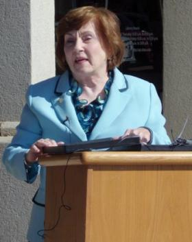 Judy McDonald speaks at the dedication ceremony of the Nacogdoches public library named in her honor.