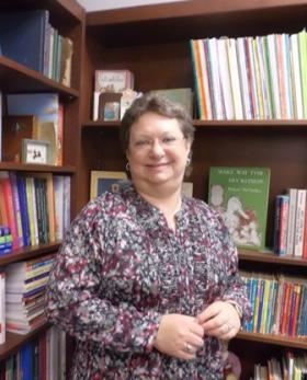 Hundreds of children's books line the office walls of Candi Bagley, an associate professor of professional practice at LSU Shreveport.