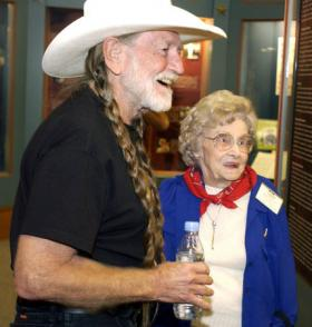 Willie Nelson and Mattie Dellinger enjoy each other's company in 2008.