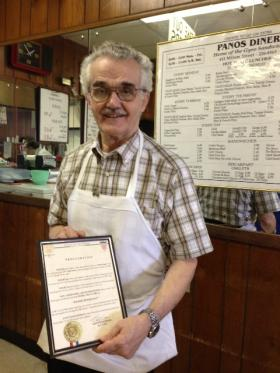 Andrew Panos holds a city proclamation from former Shreveport Mayor Keith Hightower, a loyal patron who named May 22 Panos Diner Day, back in 2000.
