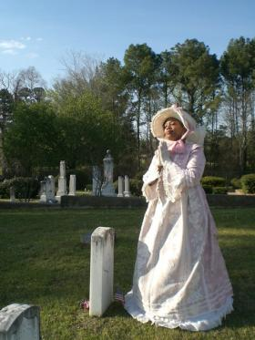 Jefferson schools superintendent Sharon Ross plays a freed slave in Jefferson's annual Twilight Cemetery Stroll. Hundreds of people are expected to turn out for the event.