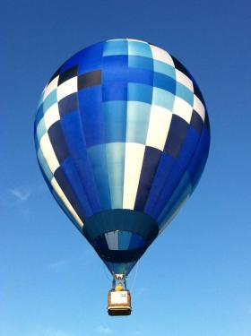 "Hot air balloon pilot Richard Sabin of Longview glides toward his first target in his balloon, ""Sea Breeze."""