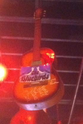 Guitar signed by the Bluebirds which hangs in the Rum Boogie Cafe on Beale Street (1988)