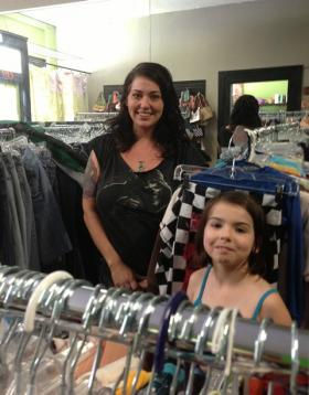Heather Scarano of Shreveport stands among racks of vintage clothes at Olive Street Thrift. She's accompanied by her 7-year-old daughter, Hendrix, who enjoys creating artwork to benefit animal welfare organizations.