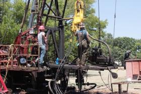 Roughnecks repair an oil well in Kilgore, Texas.