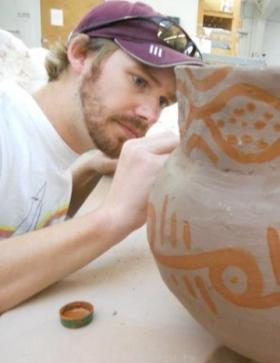 Zachary Selden, Ph.D., creates 3-D renderings of Caddo bowls and jars using a high-tech imaging device.