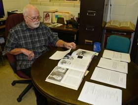 Northwestern State associate professor of history John Price prepares Charles Goodnight papers in his office as part of a project with the University of Oklahoma Press.