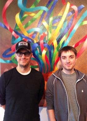 "Shreveport artists Joe Bluhm and Adam Volker stand in front of one of the paintings in their show ""Object"" at artspace."