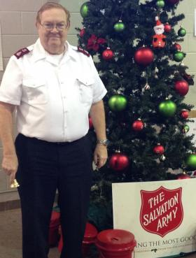 Salvation Army Commanding Officer Major David Craddock stands next to red kettles at the Salvation Army building in Shreveport.