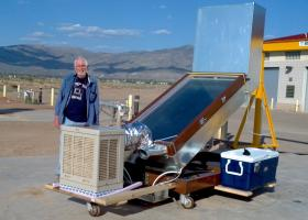 Suns River CEO Hill Kemp shows off a test unit that led to the current design of a new compact solar still for desert homes.