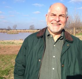 "LSU AgCenter northwest region director Patrick Colyer shows off the Red River Research Station's ""scrubbing pond."""