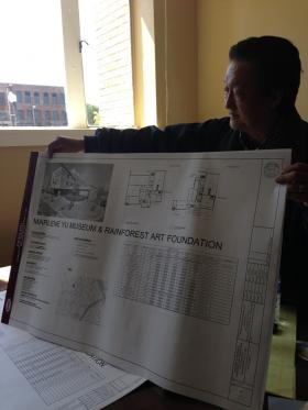 Real estate developer James Yu holds up new blueprints for the Marlene Yu Museum and Rainforest Art Foundation in downtown Shreveport.