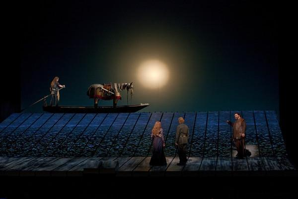 "A scene from Wagner's ""Götterdämmerung"" with Jay Hunter Morris (on boat) as Siegfried, Wendy Bryn Harmer as Gutrune, Iain Paterson as Gunther, and Hans-Peter König as Hagen."