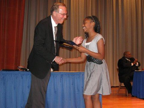 LaPREP founder Carlos Spaht presents a plaque to Ryan Hymes at last year's LaPREP awards ceremony.