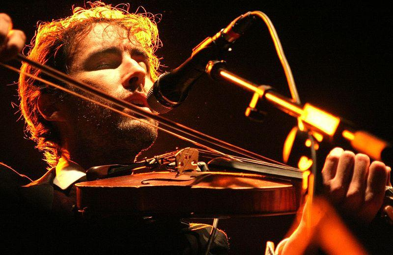 Andrew Bird with violin in concert