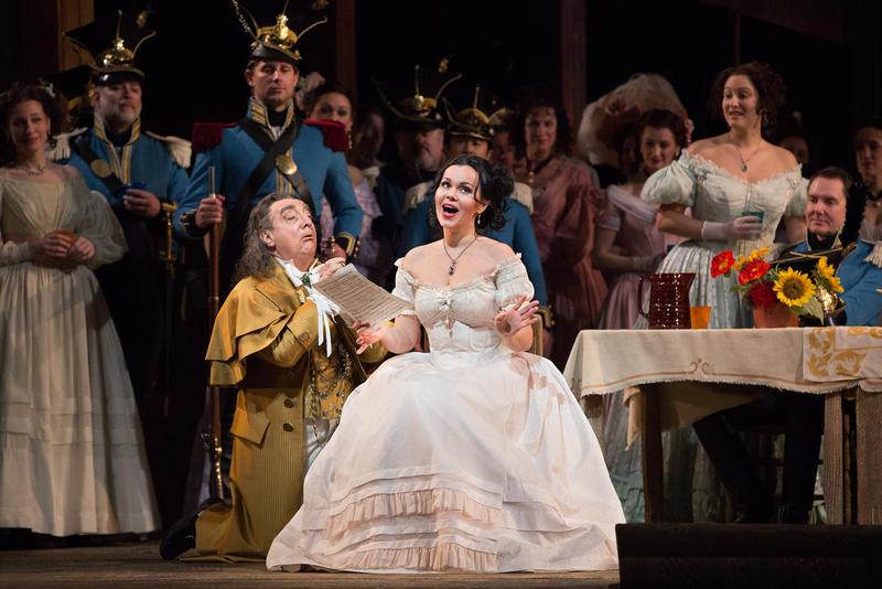 Alessandro Corbelli as Dulcamara and Aleksandra Kurzak as Adina in Donizetti's L'Elisir d'Amore