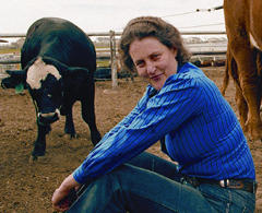 Temple Grandin with a cow