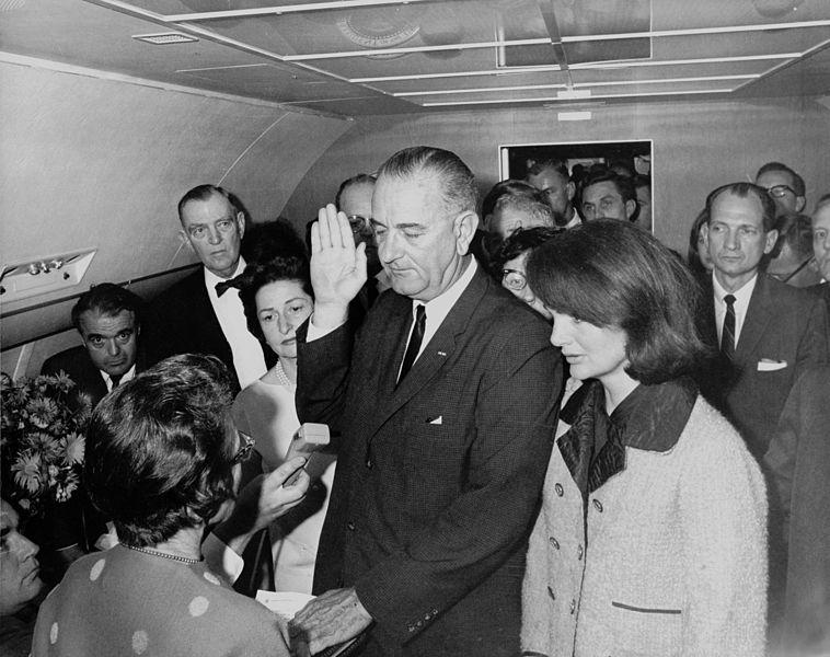 Image https://commons.wikimedia.org/wiki/File:Lyndon_B._Johnson_taking_the_oath_of_office,_November_1963.jpg