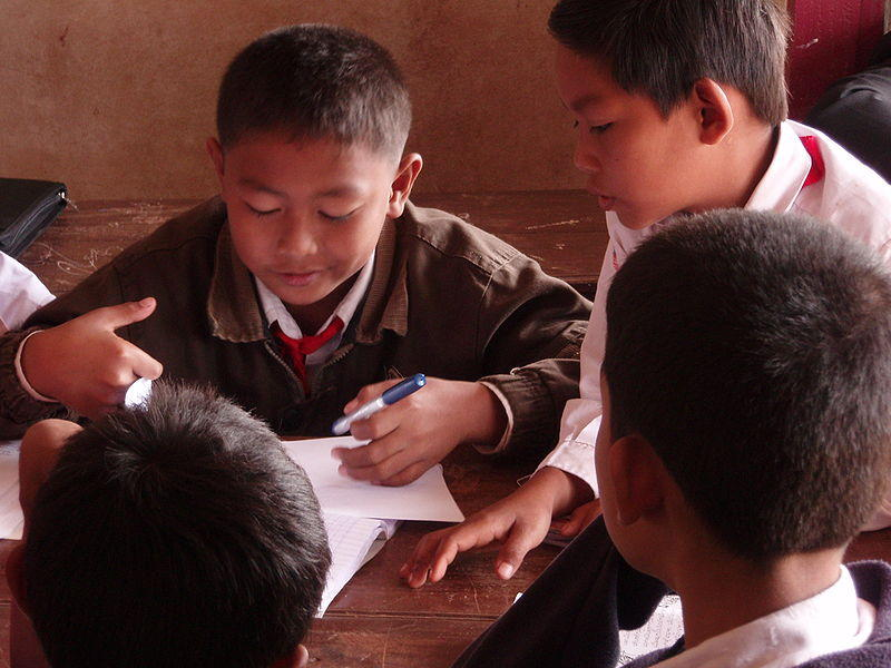 Primary pupils in group work in a small village school in southern Laos