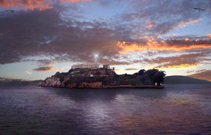 Alcatraz Island and lighthouse in San Francisco Bay, California, at sunset.