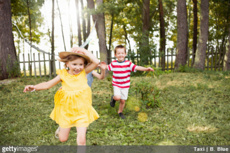 Kids running in garden