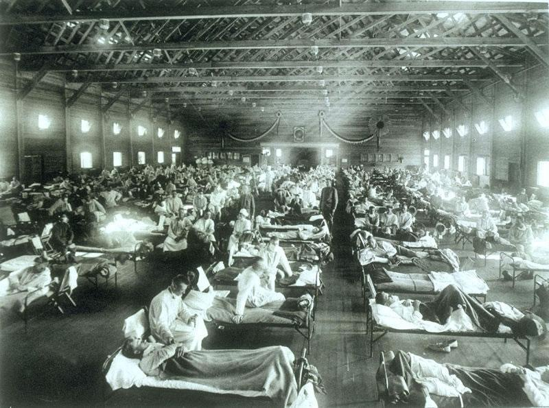 Historical photo of the 1918 Spanish influenza ward at Camp Funston, Kansas, showing the many patients ill with the flu
