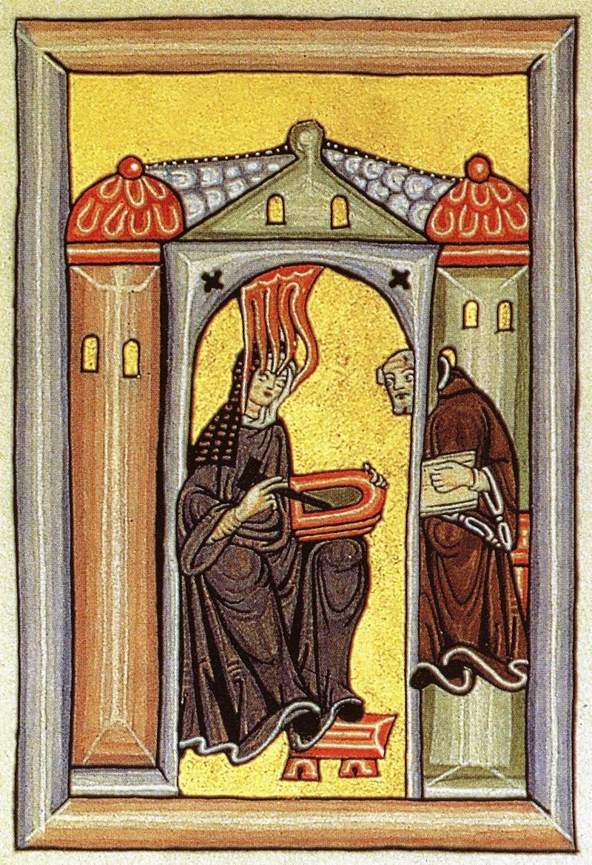 Hildegard von Bingen empfängt eine göttliche Inspiration und gibt sie an ihren Schreiber weiter.