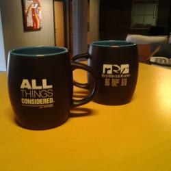All Things Considered Mug with Station Logo - Available for a $80 donation.  Enjoy your coffee with your favorite afternoon news program. The All Things Considered Mug has the ATC logo imprinted on one side of this 14 oz single wall ceramic mug.