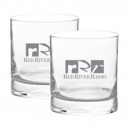Whiskey Glass Duet - $100 donation. Have that evening scotch in a pair of our whiskey glasses with your emblazoned with favorite radio station. Thick heavy base for a balanced grip, these glasses feature a cross-hatched presidential style base.