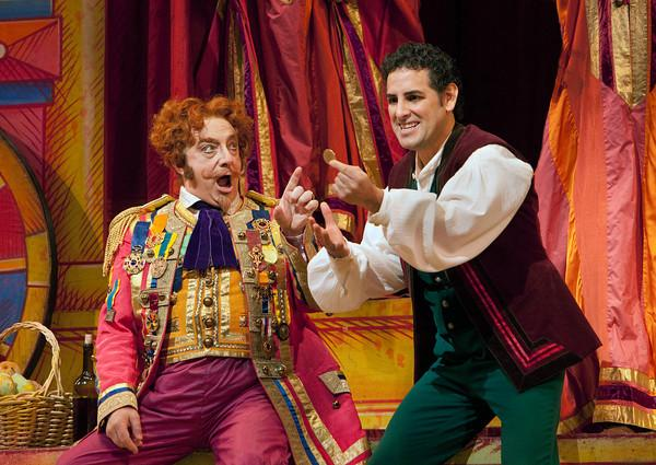 "Alessandro Corbelli as Dr. Dulcamara and Juan Diego Flórez as Nemorino in Donizetti's ""L'Elisir d'Amore."""
