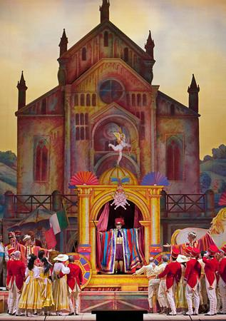 "A scene from Donizetti's ""L'Elisir d'Amore"" with Alessandro Corbelli as Dr. Dulcamara."