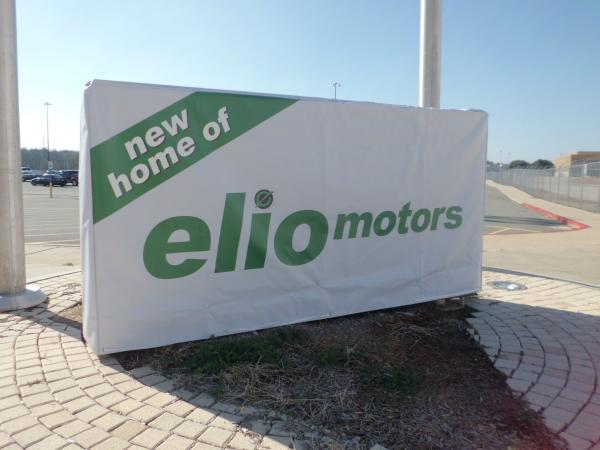 Elio Motors executives placed a temporary sign outside the former General Motors plant in Shreveport. The Phoenix-based company plans to manufacture a three-wheeled vehicle in Shreveport.