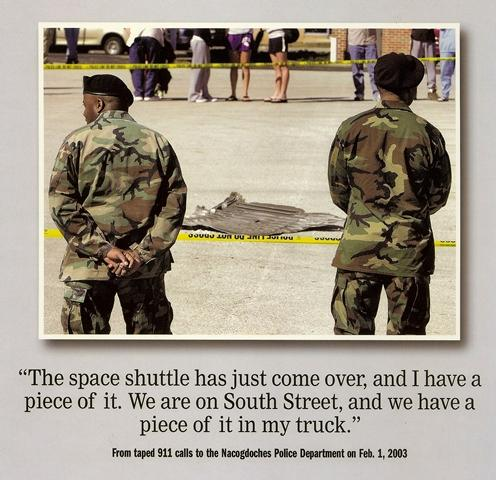 Two National Guardsmen stand over a piece of the Columbia Shuttle that landed in downtown Nacogdoches on Feb. 1, 2003.