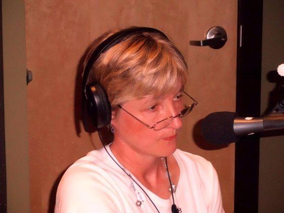 Debra Elliott Davis listen to caller.