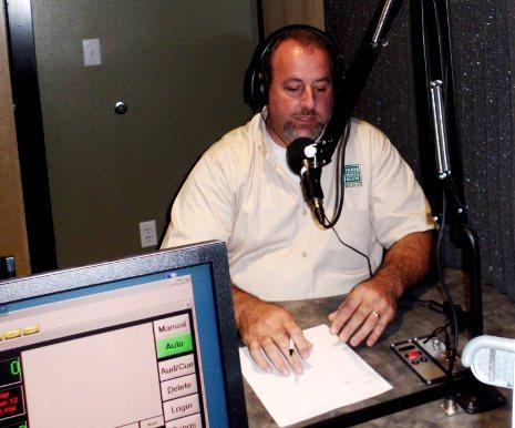 Cliff Shackelford listens as a caller asks a question.