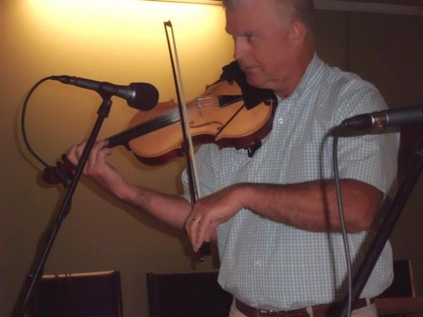 Fiddler Frank Willis in the Red River Radio Marion and Donald Weiss Performance Studio.