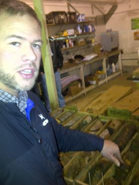 Joe Monks with Rare Element Resources showing some of the rare element core samples from the Bull Hill site.