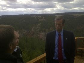 Senator John Thune standing on the deck of a West Rapid City home during a fall tour of a fire prone area.