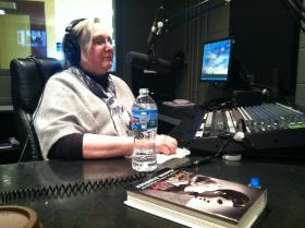 Author Jeanine Basinger talks to reporters around the world from the SDPB studio at the University of Sioux Falls.