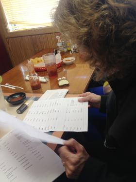 Peggy Hofmeister uses a list of words to translate menu items.