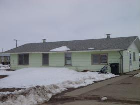 Half of this duplex on the Pine Ridge Reservation houses a family of 4 in a 1 bedroom home.